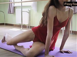 wild gymnast Inessa in a crimson dress
