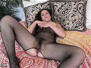 dark-haired Casey Ballerini toys her muff