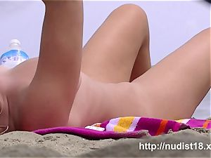 sizzling girls get bare on the beach for the spy webcam