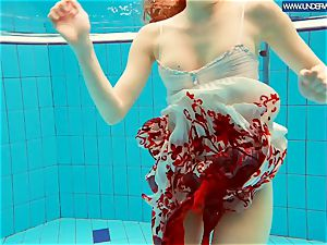 sizzling grind red-haired swimming in the pool