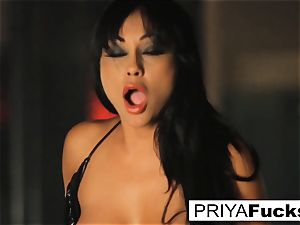 buxomy Priya Rai rails the sybian at the unclothe club